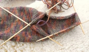 The point I've reached on my current sock project. Will to knit, waning...